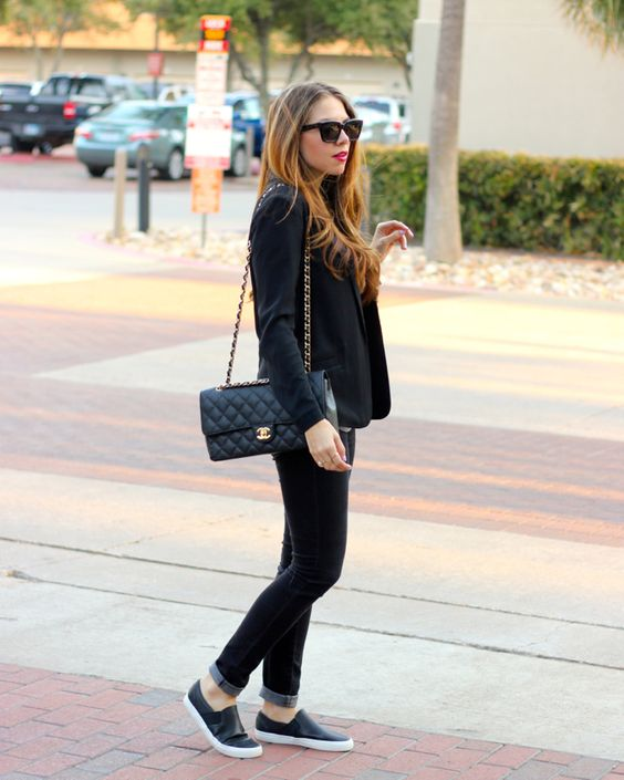 black jeans, a black jacket, black slipons and a comfy bag for a business casual look