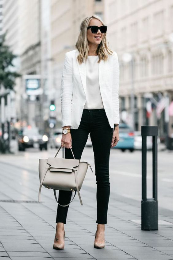 black jeans, a white top, a white jacket, nude shoes and a grey bag that spruce up the monochrome