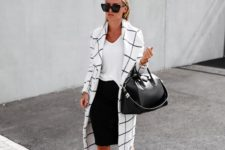 12 a black pencil skirt, a white tee, black lace up shoes and a black and white windowpane trench