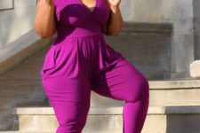 12 a fuchsia jumpsuit with a deep V-neckline and nude shoes to look jaw-dropping