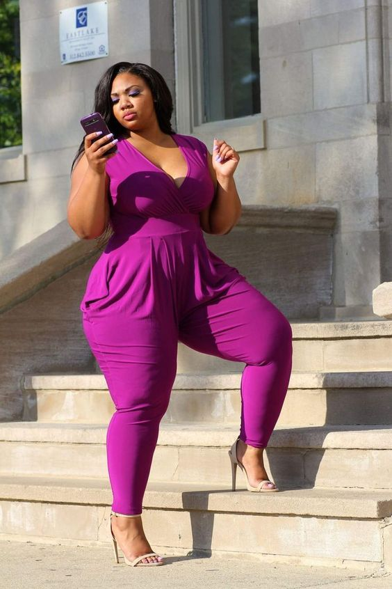 a fuchsia jumpsuit with a deep V-neckline and nude shoes to look jaw-dropping