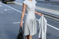 spring work outfit with a pleated skirt
