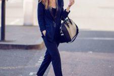 12 a navy suit, a black top, leopard print slipons and a black bag for a creative job