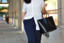 12 a very comfy and chic look with navy pants, a long white shirt, nude shoes and a black bag