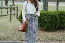 12 a white button down, a vertical striped pencil skirt, tan shoes