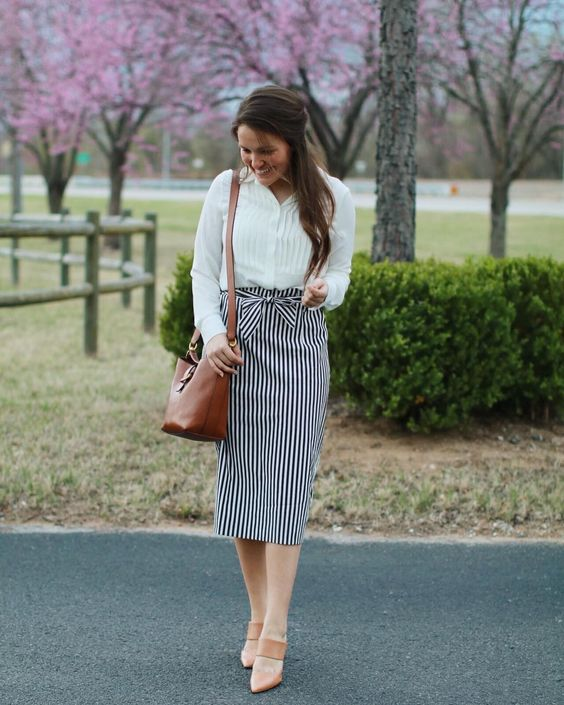 a white button down, a vertical striped pencil skirt, tan shoes
