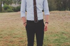 12 black pants, a light blue shirt, a black floral print tie and brown shoes