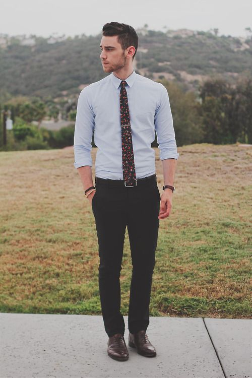 black pants, a light blue shirt, a black floral print tie and brown shoes