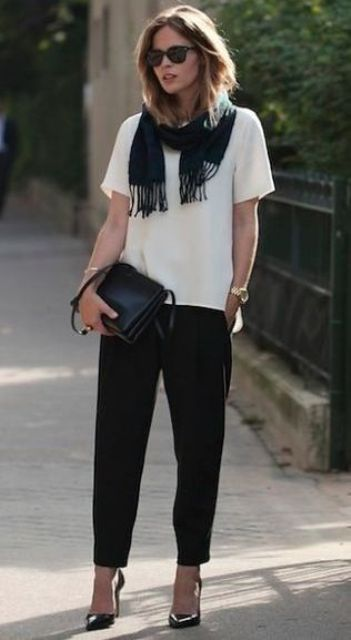 black pants, a white tee, a black scarf, black shoes and a bag for a casual work look