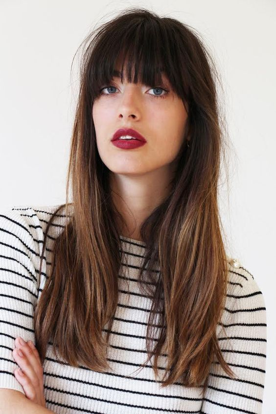 long hair with a long French fringe looks chic and always on top