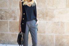13 a black top, grey gingham pants, a black long vest, heeled sandals and a bag