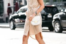 13 a blush shirtdress with shirt sleeves, blush suede cutout shoes and a small bag