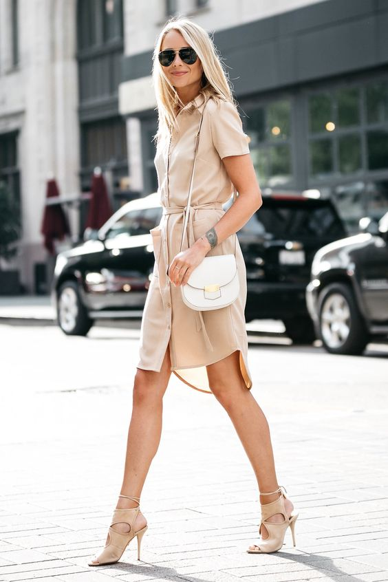 a blush shirtdress with shirt sleeves, blush suede cutout shoes and a small bag