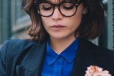 13 a short messy bob worn with a long French fringe and trendy glasses