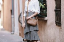 13 a white button down, a ginghm ruffle skirt, black flat shoes and a brown bag