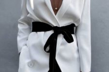 13 black pants, a white blazer with a black velvet sash with a bow for a creative office look