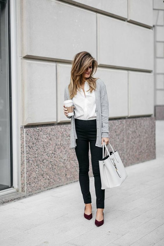 black pants, a white button down, a grey cardigan, burgundy shoes and a grey bag