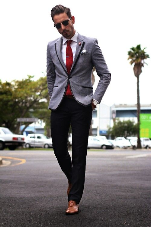 black pants, a white shirt, a red tie, a grey jacket with black lapels and cognac shoes for a touch of vintage