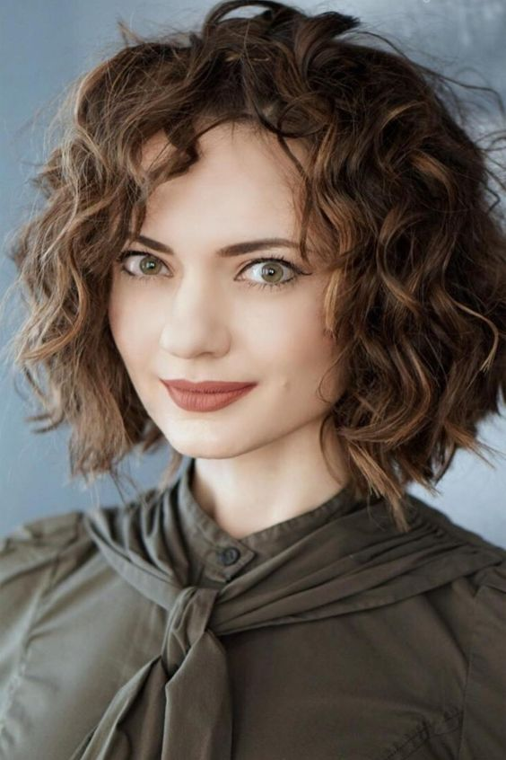 short bob with curly hair is a double trend look for 2018