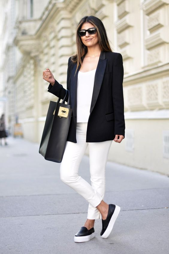 white skinnies, a white top, black slipons, a black blazer and a large tote for a casual black and white work look