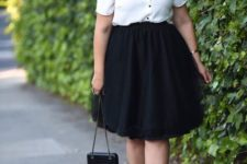 14 a black full skirt, a white blouse with black buttons and a bow and black shoes