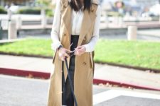 14 a black leather skirt, a white shirt, a tan long vest and black shoes for a girlish touch