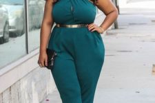 14 a dark green jumpsuit with a criss cross halter neckline and a metallic belt, black clutch and shoes for a party