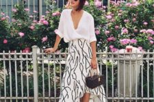 14 a printed high low midi skirt, a white button down, white sneakers and a small bag to rock