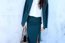 14 a teal suit with a skirt and a slit, a cream button down, a statement necklace, blush shoes