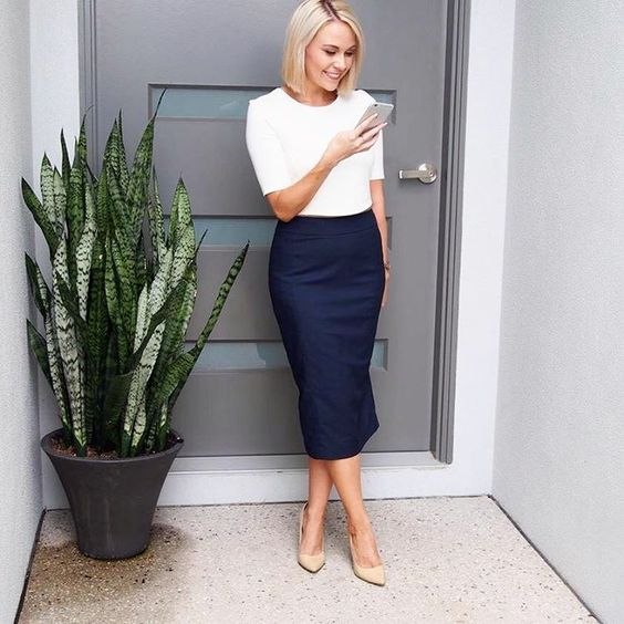 a white short sleeve top, a navy midi pencil skirt, nude shoes