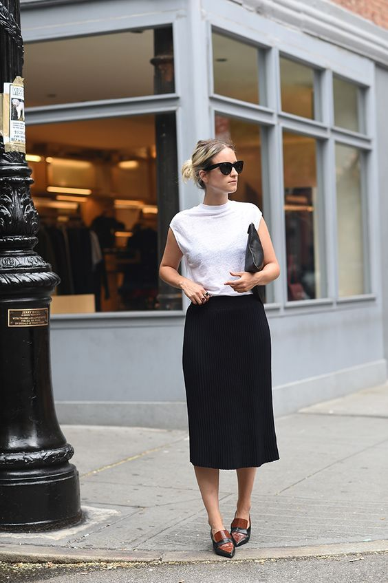 a white tee, a black thin-striped midi skirt and flat shoes for a minimal chic look