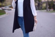 14 blue skinnies, a white shirt, nude shoes, a clutch and a long black vest for a business casual look
