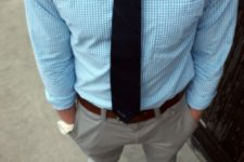 14 grey pants, a blue gingham shirt, a black striped tie and white sneakers