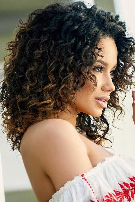 highlight your natural curls with highlights or light ombre to look even more gorgeous