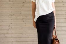 15 a black midi pencil skirt, a white loose tee, black ankle strap shoes and a brown leather bag