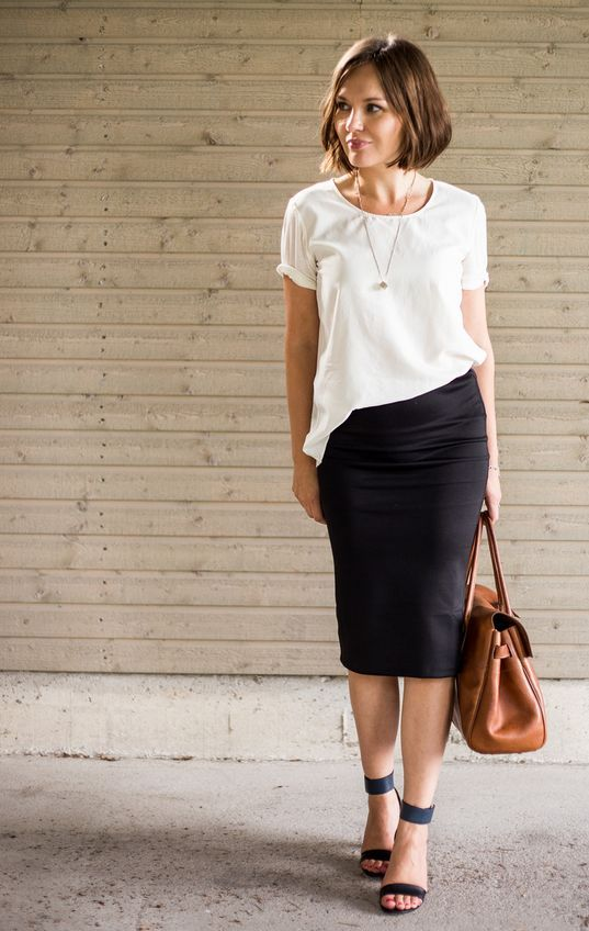 a black midi pencil skirt, a white loose tee, black ankle strap shoes and a brown leather bag