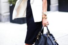 15 a black sleeveless midi dress, a creamy long vest, strappy heels and a large bag