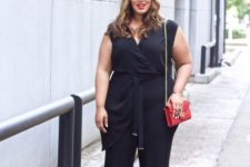 15 a black wrap jumpsuit with draping, leopard heels and a red bag for a chic look