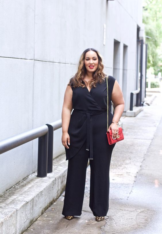 36b0887a3328 a black wrap jumpsuit with draping, leopard heels and a red bag for a chic
