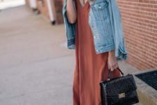 15 a rust-colored slip dress, a denim jacket, tan strappy heels and a black bag