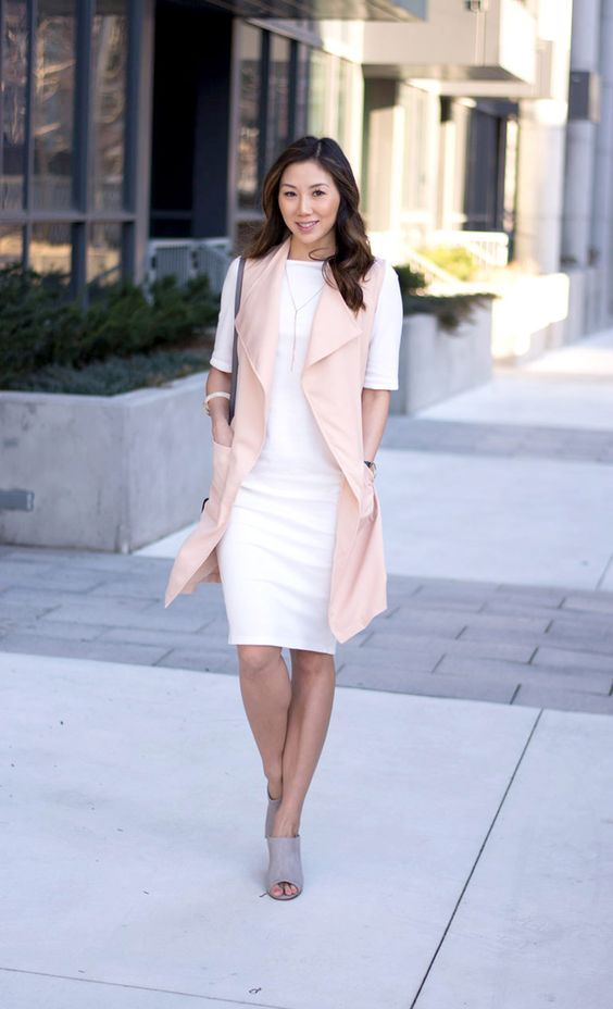 a white knee dress with short sleeves, a pink long vest and grey mules for a girlish feel