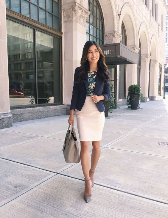 a white pencil skirt, a floral top, a navy blazer, grey shoes and a bag