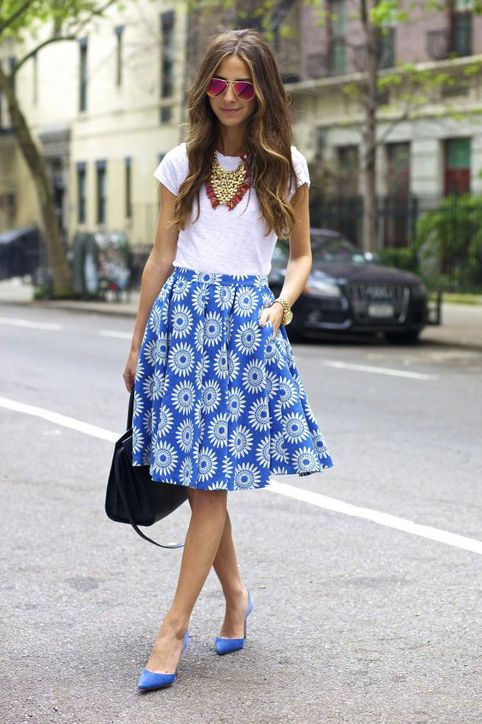 a white tee, a statement necklace, a blue printed skirt and matching shoes for a bold summer look