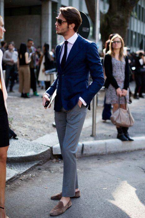 grey pants, a blue jacket, a white shirt, a black tie plus brown suede moccasins