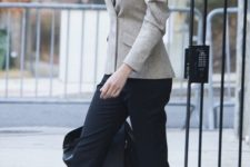 16 Ivanka Trump rocking a neutral blazer, a black top and cropped pants and polka dot kitten heels