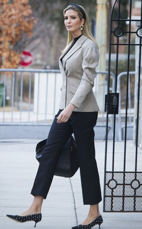 Ivanka Trump rocking a neutral blazer, a black top and cropped pants and polka dot kitten heels