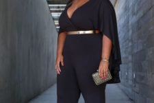 16 a chic black jumpsuit with a deep V-neckline, cape-like sleeves and a metallic belt