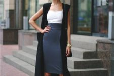 16 a grey midi knee pencil skirt, a white top, a long black vest and black ankle stap shoes