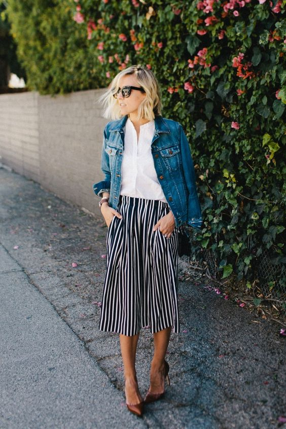 a white button down, a striped midi skirt, a denim jacket and brown shoes