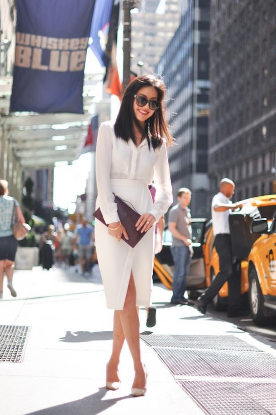 an all-white look with a button down and a midi pencil skirt with a slit plus nude shoes